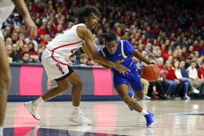 South Dakota State guard Brandon Key, right, is fouled by Arizona forward Zeke Nnaji in the first half during an NCAA college basketball game, Thursday, Nov. 21, 2019, in Tucson, Ariz. (AP Photo/Rick Scuteri)