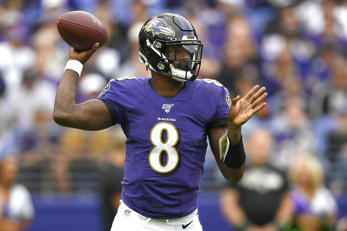 Baltimore Ravens quarterback Lamar Jackson looks to pass against the Cincinnati Bengals during the first half of a NFL football game Sunday, Oct. 13, 2019, in Baltimore. (AP Photo/Nick Wass)