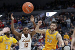 Loyola of Chicago's Marquise Kennedy (12) loses control of the ball after colliding with Valparaiso's John Kiser (33) during the second half of an NCAA college basketball game in the quarterfinal round of the Missouri Valley Conference men's tournament Friday, March 6, 2020, in St. Louis. Valparaiso won 74-73 in overtime. (AP Photo/Jeff Roberson)