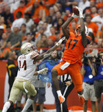 Syracuse's Jamal Custis, right, leaps for a pass as Florida State's Kyle Meyers, left, defends in the third quarter of an NCAA college football game in Syracuse, N.Y., Saturday, Sept. 15, 2018. (AP Photo/Nick Lisi)