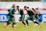 In this slow speed shutter photo, players run during the training session of Portugal at the 2018 soccer World Cup in Kratovo, outskirts Moscow, Russia, Wednesday, June 13, 2018. (AP Photo/Francisco Seco)