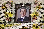 In this photo provided by Seoul Metropolitan Government, a portrait of the deceased Seoul Mayor Park Won-soon is placed at a hospital in Seoul, South Korea, Friday, July 10, 2020. Seoul's mayor left a note saying he felt