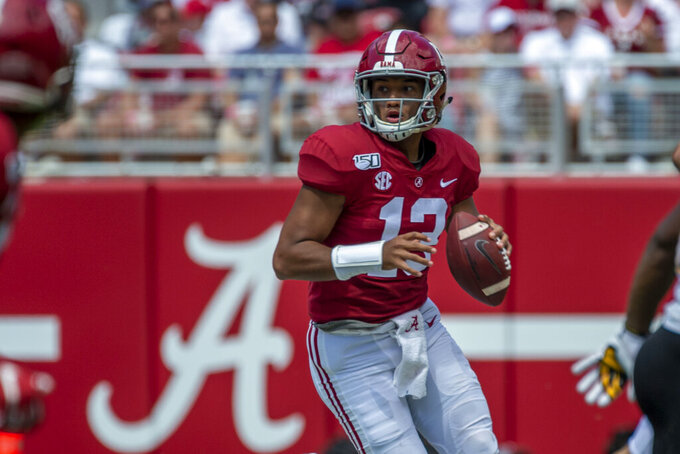 Alabama quarterback Tua Tagovailoa (13) rolls out to throw against Southern Miss during the second half of an NCAA college football game, Saturday, Sept. 21, 2019, in Tuscaloosa, Ala. (AP Photo/Vasha Hunt)