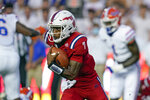 Florida Atlantic quarterback N'Kosi Perry (7) runs during the first half of the team's NCAA college football game against Florida, Saturday, Sept. 4, 2021, in Gainesville, Fla. (AP Photo/John Raoux)