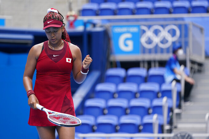 Naomi Osaka, of Japan, reacts during a second round tennis match against Viktorija Golubic, of Switzerland, at the 2020 Summer Olympics, Monday, July 26, 2021, in Tokyo, Japan. (AP Photo/Patrick Semansky)