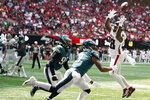 Atlanta Falcons running back Mike Davis (28) misses the catch against Philadelphia Eagles Steven Nelson (3) during the first half of an NFL football game, Sunday, Sept. 12, 2021, in Atlanta. (AP Photo/Brynn Anderson)