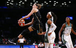 New York Liberty guard Rebecca Allen drives to the basket against Seattle Storm guard Jordin Canada (21) during the second half of a WNBA basketball game Wednesday, Aug. 18, 2021, in New York. (AP Photo/Noah K. Murray)