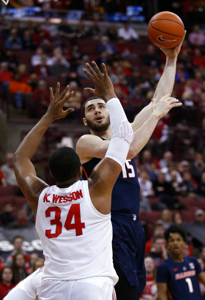 Illinois forward Giorgi Bezhanishvili, right, goes up for a shot against Ohio State forward Kaleb Wesson during the first half of an NCAA college basketball game in Columbus, Ohio, Thursday, Feb. 14, 2019. (AP Photo/Paul Vernon)