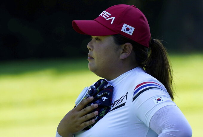 Inbee Park, of South Korea, refreshes with an ice pack on the 14th hole during the second round of the women's golf event at the 2020 Summer Olympics, Thursday, Aug. 5, 2021, at the Kasumigaseki Country Club in Kawagoe, Japan. (AP Photo/Matt York)