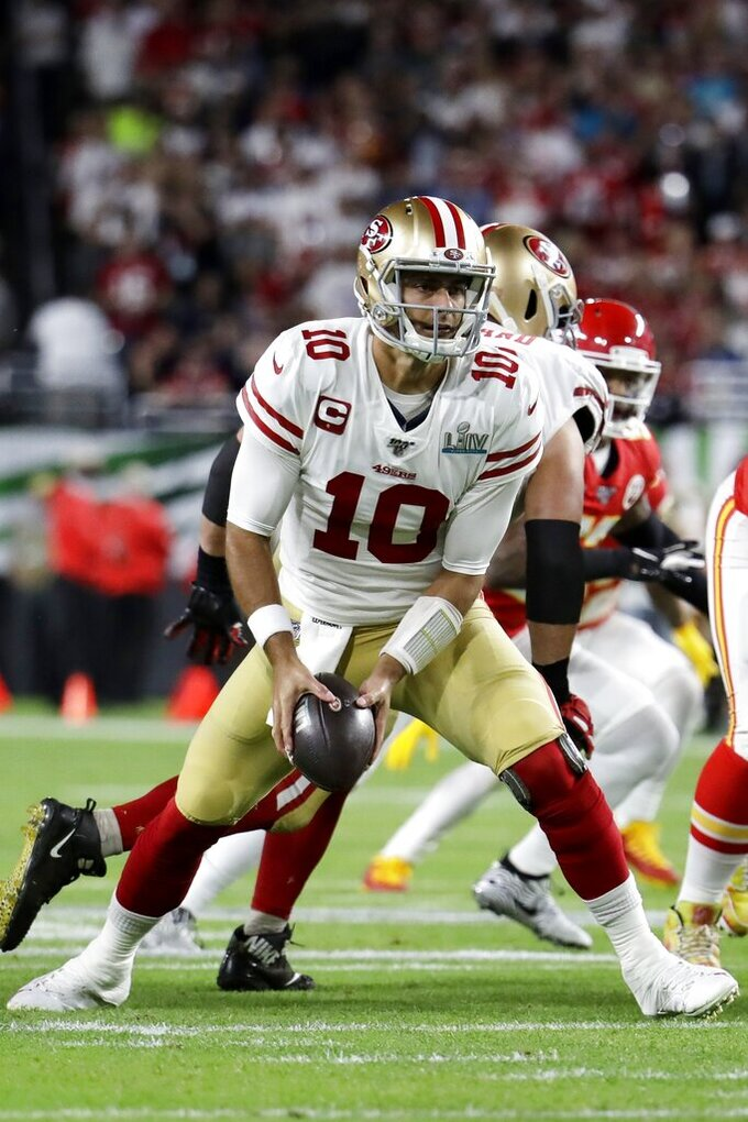 San Francisco 49ers quarterback Jimmy Garoppolo (10) pitches the ball against the Kansas City Chiefs during the first half of the NFL Super Bowl 54 football game Sunday, Feb. 2, 2020, in Miami Gardens, Fla. (AP Photo/Lynne Sladky)
