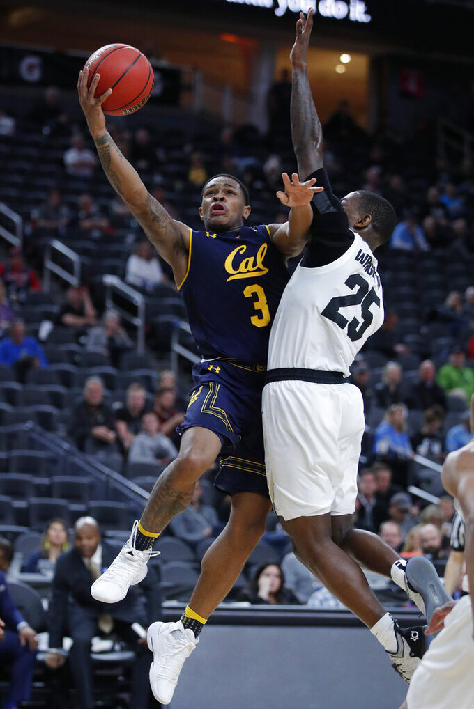 California's Paris Austin shoots around Colorado's McKinley Wright IV during the second half of an NCAA college basketball game in the first round of the Pac-12 men's tournament Wednesday, March 13, 2019, in Las Vegas. (AP Photo/John Locher)
