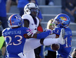 Kansas cornerbacks Elmore Hempstead Jr. (23) and Hasan Defense (13) break up a pass intended for TCU wide receiver Jalen Reagor (1) during the second half of an NCAA college football game in Lawrence, Kan., Saturday, Oct. 27, 2018. (AP Photo/Orlin Wagner)
