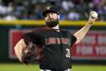 Arizona Diamondbacks pitcher Robbie Ray throws against the Los Angeles Dodgers in the first inning of a baseball game Saturday, Aug. 31, 2019, in Phoenix. (AP Photo/Rick Scuteri)