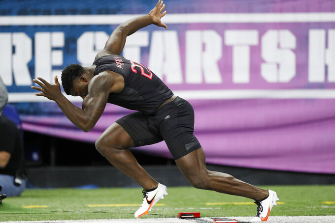 FILE - In this Feb. 29, 2020, file photo, Oklahoma linebacker Kenneth Murray runs the 40-yard dash at the NFL football scouting combine in Indianapolis. With their blazing speed on offense, the Kansas City Chiefs ran away from their AFC West brethren en route to their first Super Bowl title in half a century. The Chargers moved up in the first round to select fleet-footed Oklahoma linebacker Kenneth Murray, whom they envision stuffing running back Damien Williams and chasing down QB Patrick Mahomes. (AP Photo/Charlie Neibergall, File)