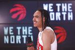 Toronto Raptors' Dalano Banton speaks to media at Scotiabank Arena during the NBA basketball team's media day in Toronto, Monday, Sept. 27, 2021. (Cole Burston/The Canadian Press via AP)