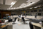 """In this photo taken on Tuesday, July 16, 2019, a specialist works at the control panel of the Ignalina nuclear power plant (NPP) in Visaginas some 160km (100 miles) northeast of the capital Vilnius, Lithuania. The HBO TV series """"Chernobyl"""" featuring Soviet era nuclear nightmares is drawing tourists to the atomic filming locations and helping Lithuania grow as a tourist destination. (AP Photo/Mindaugas Kulbis)"""