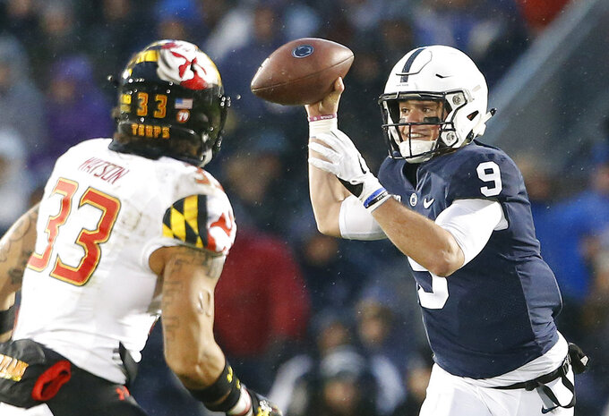 Penn State quarterback Trace McSorley (9) looks to pass as Maryland's Tre Watson (33) applies the pressure during the first half of an NCAA college football game in State College, Pa., Saturday, Nov. 24, 2018. (AP Photo/Chris Knight)