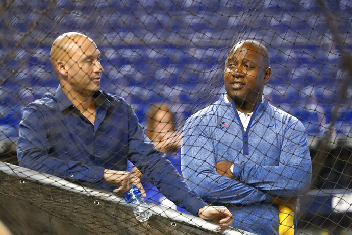 FILE - In this Wednesday, Aug. 28, 2019, file photo, Miami Marlins CEO Derek Jeter, left, and Michael Hill, President of Baseball Operations, watch batting practice before the start of a baseball game against the Cincinnati Reds, in Miami. Marlins executive Michael Hill's 19-season tenure with the franchise has ended. Hill was president of baseball operations for the past six years and provided continuity after a 2017 change in ownership, but he will not be back next year, CEO Derek Jeter said Sunday, Oct. 18, 2020.(AP Photo/Wilfredo Lee, File)