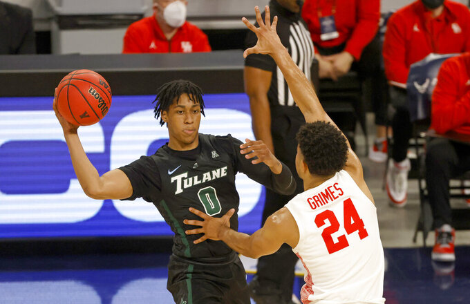 Tulane guard Gabe Watson (0) looks to pass around Houston guard Quentin Grimes (24) during the first half of an NCAA college basketball game in the quarterfinal round of the American Athletic Conference men's tournament Friday, March 12, 2021, in Fort Worth, Texas. (AP Photo/Ron Jenkins)