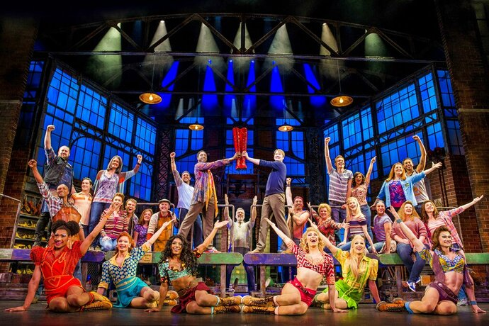 This image released by Fathom Events shows the cast during a performance of the musical