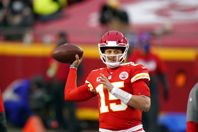 Kansas City Chiefs quarterback Patrick Mahomes warms up before the AFC championship NFL football game against the Buffalo Bills, Sunday, Jan. 24, 2021, in Kansas City, Mo. (AP Photo/Charlie Riedel)