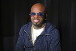 "FILE - In this May 24, 2018, file photo, entertainer Jermaine Dupri is shown during an interview in New York. Big-name entertainers believe social injustice needs to be addressed during the Super Bowl and are ensuring the topic that ignited a political firestorm and engulfed the NFL will be in the spotlight.  Dupri says he was called a ""sellout"" during a meeting with people who had lost family members as result of police brutality. The music mogul plans to give mothers a platform to speak onstage during his Super Bowl Live event in Atlanta. (AP Photo/John Carucci, File)"