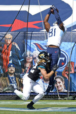 Tennessee Titans tight end Jonnu Smith (81) catches a touchdown pass over Jacksonville Jaguars safety Andrew Wingard (42) in the first half of an NFL football game Sunday, Sept. 20, 2020, in Nashville, Tenn. (AP Photo/Mark Zaleski)