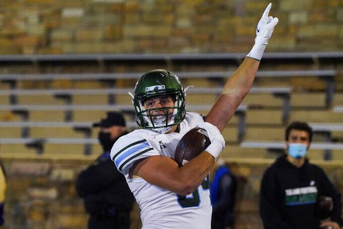 Tulane tight end Will Wallace celebrates his touchdown against Tulsa during the second half of an NCAA college football game in Tulsa, Okla., Thursday, Nov. 19, 2020. (AP Photo/Sue Ogrocki)