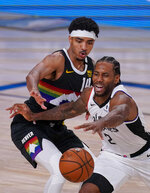 Los Angeles Clippers' Kawhi Leonard (2) reaches for the ball as Denver Nuggets' Gary Harris (14) defends during the second half of an NBA conference semifinal playoff basketball game Monday, Sept. 7, 2020, in Lake Buena Vista, Fla. (AP Photo/Mark J. Terrill)