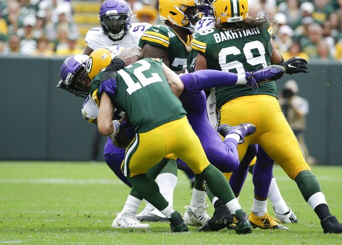 Minnesota Vikings' Danielle Hunter sacks Green Bay Packers' Aaron Rodgers during the second half of an NFL football game Sunday, Sept. 15, 2019, in Green Bay, Wis. The Packers won 21-16. (AP Photo/Mike Roemer)