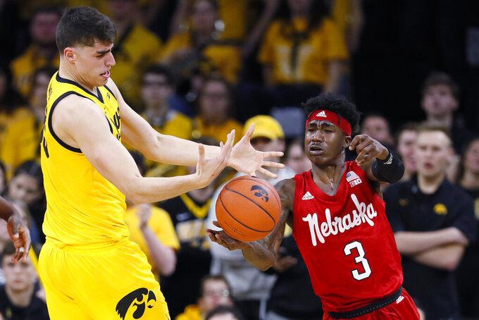 Nebraska guard Cam Mack (3) steals the ball from Iowa center Luka Garza during the first half of an NCAA college basketball game, Saturday, Feb. 8, 2020, in Iowa City, Iowa. (AP Photo/Charlie Neibergall)