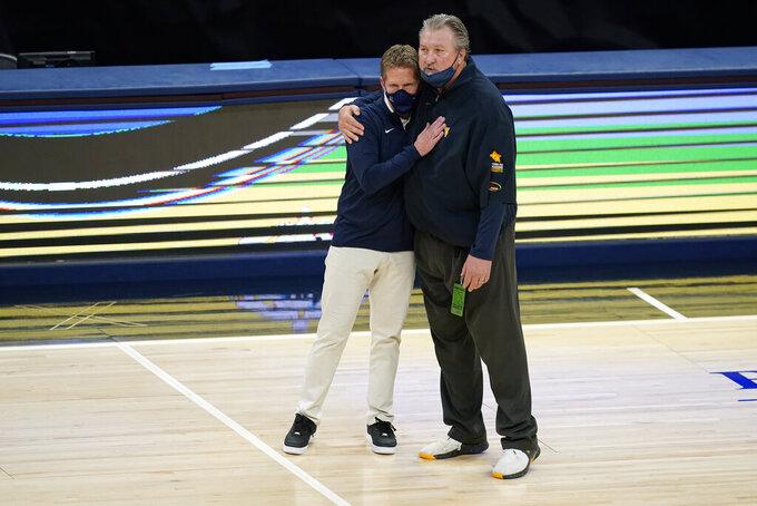 Gonzaga coach Mark Few, left, hugs West Virginiacoach Bob Huggins following an NCAA college basketball game, Wednesday, Dec. 2, 2020, in Indianapolis. Gonzaga won 87-82. (AP Photo/Darron Cummings)