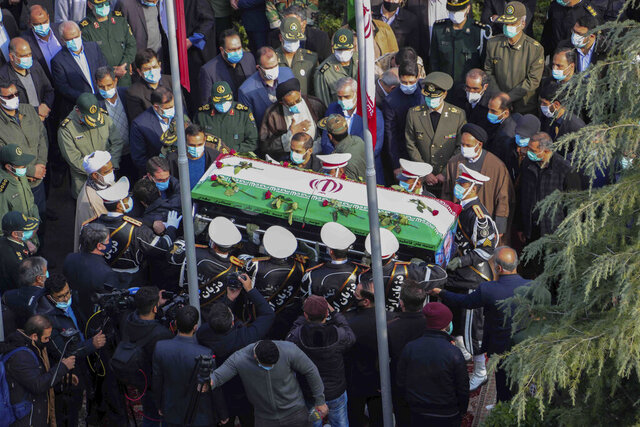 In this photo released by the official website of the Iranian Defense Ministry, military personnel carry the flag draped coffin of Mohsen Fakhrizadeh, a scientist who was killed on Friday, in a funeral ceremony in Tehran, Iran, Monday, Nov. 30, 2020. Iran held the funeral service for Fakhrizadeh, who founded its military nuclear program two decades ago, with the Islamic Republic's defense minister vowing to continue the man's work