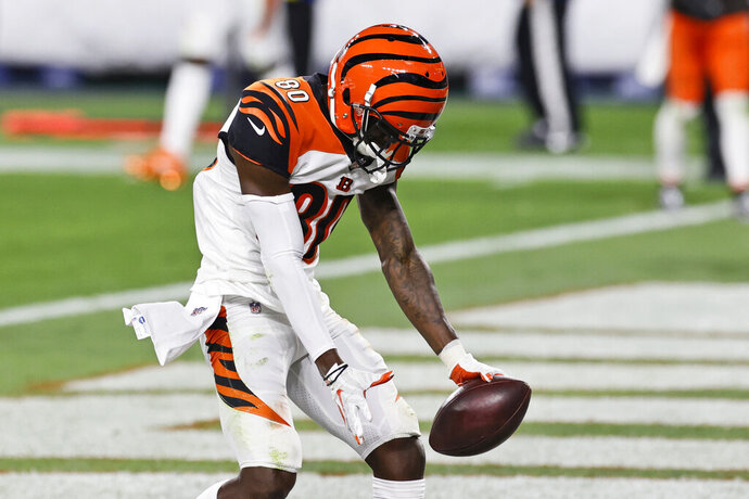 Cincinnati Bengals wide receiver Mike Thomas celebrates after scoring a 4-yard touchdown during the second half of the team's NFL football game against the Cleveland Browns, Thursday, Sept. 17, 2020, in Cleveland. (AP Photo/Ron Schwane)