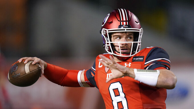 Utah quarterback Jake Bentley warms up for the team's NCAA college football game against Oregon State on Saturday, Dec. 5, 2020, in Salt Lake City. (AP Photo/Rick Bowmer)