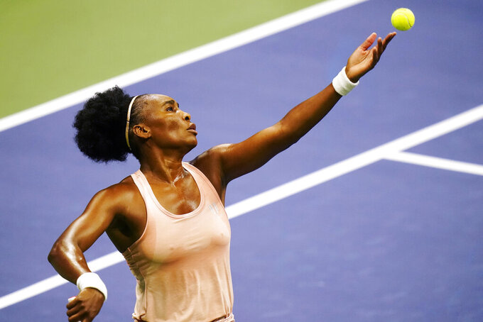 Venus Williams, of the United States, serves to Karolina Muchova, of the Czech Republic, during the first round of the U.S. Open tennis championships, Tuesday, Sept. 1, 2020, in New York.(AP Photo/Frank Franklin II)