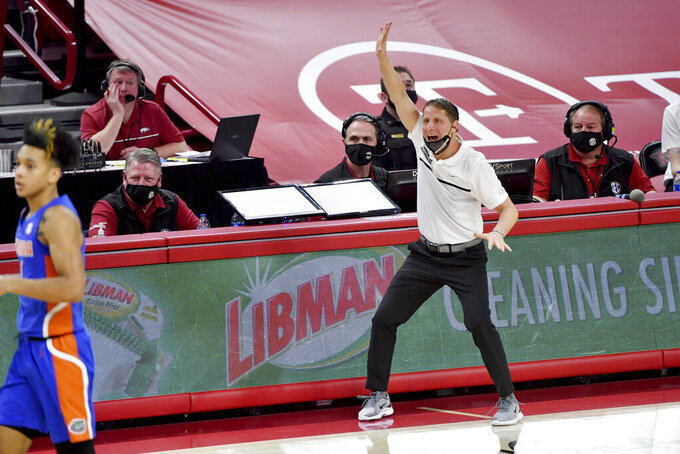 Arkansas coach Eric Musselman reacts on the sideline against Florida during the second half of an NCAA college basketball game in Fayetteville, Ark. Tuesday, Feb. 16, 2021. (AP Photo/Michael Woods)