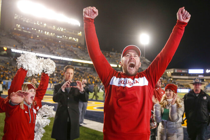 Oklahoma coach Lincoln Riley yells after the team's 59-56 win over West Virginia during an NCAA college football game in Morgantown, W.Va., Friday, Nov. 23, 2018. Oklahoma earned a spot in the Big 12 championship game. (Ian Maule/Tulsa World via AP)