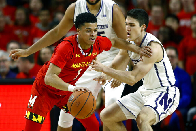 Maryland guard Anthony Cowan Jr., left, drives against Northwestern guard Ryan Greer in the first half of an NCAA college basketball game, Tuesday, Jan. 29, 2019, in College Park, Md. (AP Photo/Patrick Semansky)