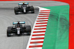 Mercedes driver Lewis Hamilton of Britain steers his car followed by Mercedes driver Valtteri Bottas of Finland during the second practice session at the Red Bull Ring racetrack in Spielberg, Austria, Friday, July 3, 2020. The Austrian Formula One Grand Prix will be held on Sunday. (Leonhard Foeger/Pool via AP)