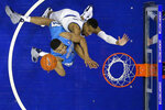 Georgetown's Trey Mourning, left, goes for a shot against Villanova's Phil Booth during the first half of an NCAA college basketball game, Sunday, Feb. 3, 2019, in Philadelphia. (AP Photo/Matt Slocum)