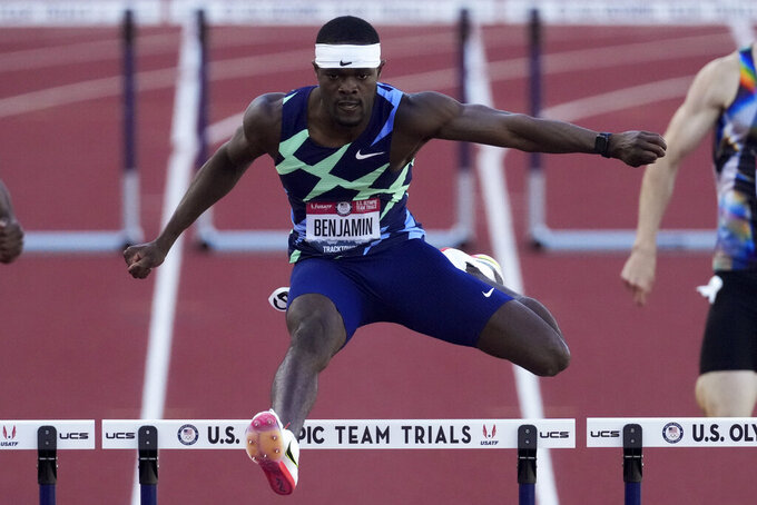 Rai Benjamin wins the men's 400-meter hurdles at the U.S. Olympic Track and Field Trials Saturday, June 26, 2021, in Eugene, Ore. (AP Photo/Ashley Landis)