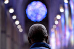 Artist Kerry James Marshall stands in the main hall of the National Cathedral after being selected to design a replacement of former confederate-themed stained glass windows that were taken down in 2017, in Washington, Thursday, Sept. 23, 2021. The Cathedral has also commissioned Pulitzer-nominated poet Elizabeth Alexander to pen a poem that will be inscribed in the stone beneath the new windows. (AP Photo/Andrew Harnik)