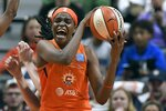 Connecticut Sun's Jonquel Jones grabs a rebound against the Washington Mystics during the first half in Game 3 of basketball's WNBA Finals, Sunday, Oct. 6, 2019, in Uncasville, Conn. (AP Photo/Jessica Hill)
