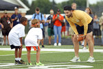 Cleveland Browns quarterback Baker Mayfield talks with participants at the Baker Mayfield ProCamp in Gates Mills, Ohio, Wednesday, July 21, 2021.(Joshua Gunter/Cleveland.com via AP)