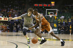 Texas guard Matt Coleman III, right, drives on Baylor guard Matthew Mayer, left, in the first half of an NCAA college basketball game, Saturday, Jan. 4, 2020, in Waco, Texas. (AP Photo/Rod Aydelotte)