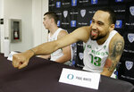 Oregon's Paul White is greeted during the Pac-12 NCAA college basketball media day Thursday, Oct. 11, 2018, in San Francisco. (AP Photo/Eric Risberg)