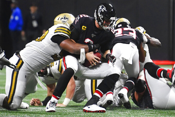 New Orleans Saints defensive tackle Sheldon Rankins (98) sacks Atlanta Falcons quarterback Matt Ryan (2) during the second half of an NFL football game, Thursday, Nov. 28, 2019, in Atlanta. The New Orleans Saints won 26-18. Ryan was sacked nine times in the game. (AP Photo/John Amis)