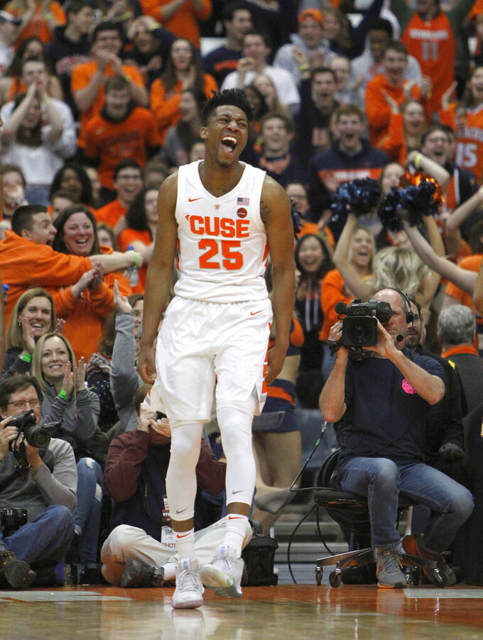 Syracuse's Tyus Battle celebrates after scoring a basket during the second half of an NCAA college basketball game against Boston College in Syracuse, N.Y., Saturday, Feb. 9, 2019. Syracuse won 67-56. (AP Photo/Nick Lisi)
