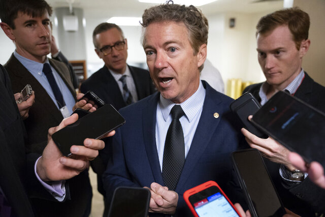 FILE - In this Nov. 6, 2019, file photo, Sen. Rand Paul, R-Ky., responds to reporters at the Capitol in Washington. Paul wants to combat the rising debt load for college students by allowing them to dip into retirement accounts to help pay for school or pay back loans. (AP Photo/J. Scott Applewhite, File)